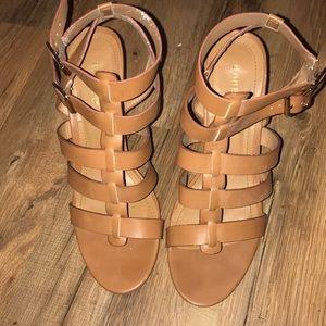 Gladiator blocked heel sandal.